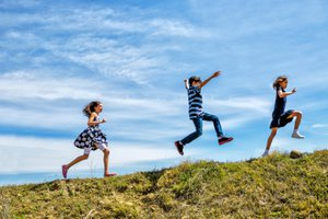 Children running and jumping outdoors